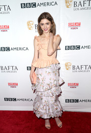 Natalia Dyer amped up the feminine feel with a lavender floral ruffle skirt, also by Brock Collection.