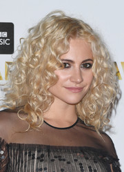 Pixie Lott styled her hair with voluminous curls for the BBC Music Awards.