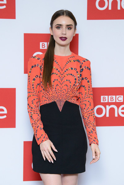 More Pics of Lily Collins Print Dress (9 of 18) - Dresses & Skirts Lookbook - StyleBistro [les miserables,fashion model,clothing,orange,dress,red,shoulder,cocktail dress,fashion,premiere,hairstyle,lily collins,photocall,photocall,england,london,bbc one,bafta]