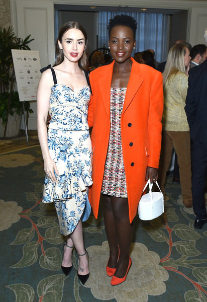 Lupita Nyong'o couldn't be missed in her bright orange coat at the BBCA BAFTA Tea Party.