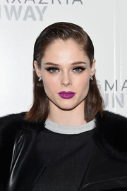 Coco Rocha went for an eye-catching beauty look with a bold berry lip.