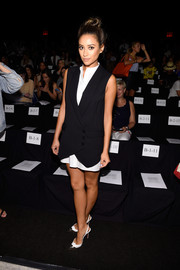 Shay Mitchell was androgynous-chic in a black tux-style vest layered over an LWD at the BCBG Max Azria fashion show.