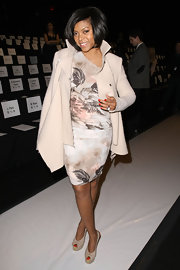 Taraji looked retro glamorous at the BCBG Max Azria show in blush bow-adorned peep toe slingbacks.
