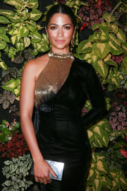 Camila Alves paired a black box clutch with a one-sleeve dress for the Bella Los Angeles summer issue party.