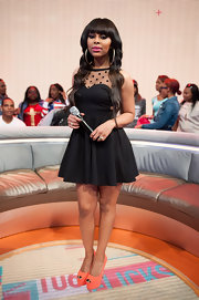 Paigion chose this LBD with a polka dot, illusion neckline for her appearance on '106 and Park.'