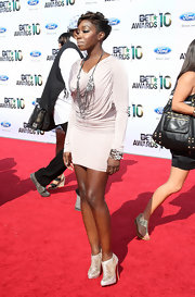 Estelle wore a beautiful pair of sheer ankle booties with a nude mini dress and statement jewelry.