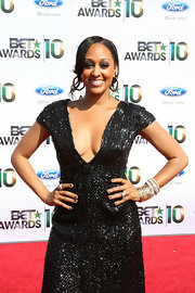 Tia Mowry showed off her gold bangle bracelets while walking the red carpet at the BET Awards.