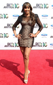 Vivica opted for a nude mini dress with a beaded, black overlay.