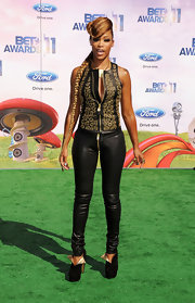 Eve chose an edgy black and gold-themed ensemble for the 2011 BET Awards, consisting of a leather tank, skinnies, and suede ankle boots.