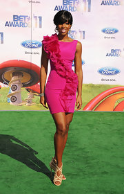 Kelly Rowland added wow factor to her fuchsia cocktail dress with detailed nude cutout sandals at the 2011 BET Awards.
