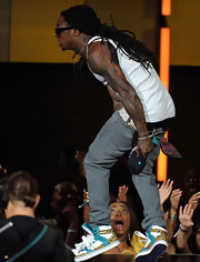 Lil Wayne jumped on stage in a pair of leopard print and turquoise sneakers.