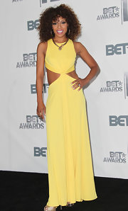 Wendy Raquel Robinson brought a bright burst of color to the BET Awards with an alluring yellow cutout dress.