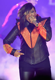 Leave it to fashion daredevil Missy Elliott to wear something leather, neon, and spiked all at once.
