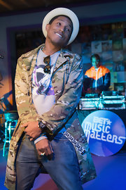 Pharrell Williams opted for a camouflage utility jacket for his look at the BET Music Matter Showcase at SXSW.