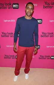Jay Ellis tried his hand at color blocking when he sported this navy sweater paired with red pants.