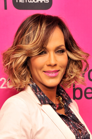 Nicole Ari Parker showed off her highlights with these lively, bouncy curls.