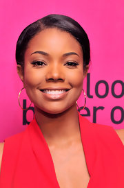 Gabrielle Union added just a touch of color to her beauty look with a swipe of pastel pink lipstick.