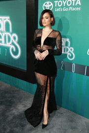 Kehlani showed some skin in a partially sheer black gown by House of CB at the 2017 Soul Train Awards.