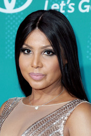 Toni Braxton wore her hair long and straight with a center part at the 2017 Soul Train Awards.