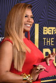 Queen Latifah attended the American Black Film Festival Honors carrying an on-trend red envelope clutch by Tyler Ellis.
