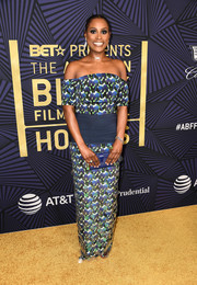 Issa Rae finished off her look with a blue hard-case clutch by Edie Parker.