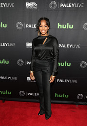 Anika Noni Rose donned a long-sleeve black silk blouse with a slashed yoke for the 'Evening With the Quad' event at the Paley Center.