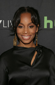 Anika Noni Rose attended the 'Evening with the Quad' event at the Paley Center wearing a mildly messy center-parted updo.