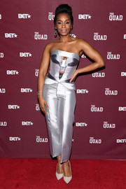 Anika Noni Rose made a bold statement in a metallic cutout tube top by Rubin Singer at the premiere of 'The Quad.'