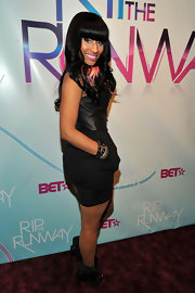 Nicki Minaj showed off her hot pink pedicure at the 2010 BET Rip the Runway in black fold over ankle booties.
