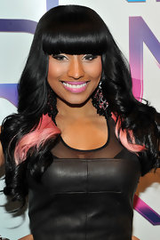 Up and coming Rap star Nicki Minaj showed off her black and highlighted pink hair style. Although the placement of her pink accented hair is a bit strange.