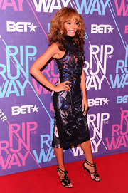 Selita Ebanks wore this shining cosmic cocktail dress on the Rip the Runway red carpet.
