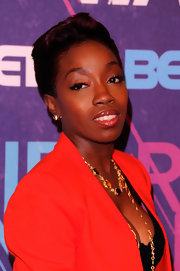 Estelle attended BET's 2012 Rip the Runway wearing long lashes and sexy sweeps of liquid eyeliner.