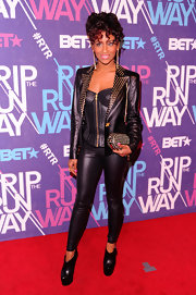 Guyana paired her look with black platform leather ankle boots.