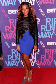 Angela Simmons topped off her look with sky-high snakeskin platform pumps.