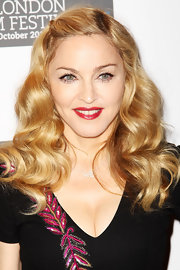 Madonna looked perfect with her pin-up girl curls and ruby red lips at the London Film Festival.