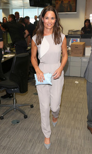 Pippa Middleton complemented her jumpsuit with a pair of gray suede pumps.