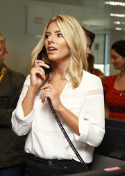 Mollie King participated in the BGC Global Charity Day wearing a stylish white wrap blouse by Finders Keepers.