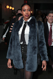 Condola Rashad arrived for the premiere of 'Billions' season 3 wearing a fur coat over a ruffle blouse and shorts.