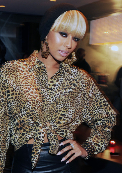 Keri Hilson amped up her leopard print blouse and leather skirt with gold dangle earrings. She topped off her funky look with a knit beanie and smoky lids.
