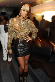 Keri wears a leather mini with her leopard print blouse while out in Atlanta.