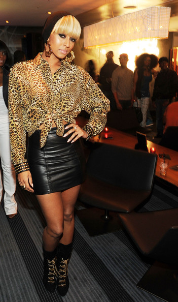 Keri gets wild in leopard print and a leather mini while out in Atlanta.