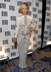 Keri made a statement in a white beaded evening gown with a deep key hole neckline at the BMI Pop Music Awards.