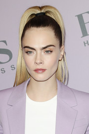 Cara Delevingne rocked a perfectly styled high ponytail at the Boss Fall 2020 show.