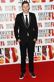 Professor Green pulled off a black suit and basketball sneakers combo at the 2011 Brit Awards.