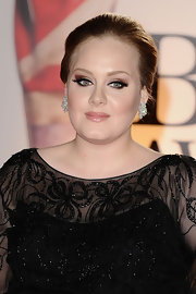 Adele added bling to her look with a pair of diamond earrings at the Brit Awards.