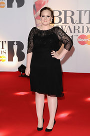 Adele donned a glittering black cocktail dress for the Brit Awards.