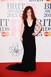Jess Glynne chose a fab black gown with a plunging neckline and train for the BRIT Awards.