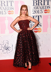Paloma Faith arrived at the BRIT Awards in a show-stopping red and black gown with a sexy mesh overlay.