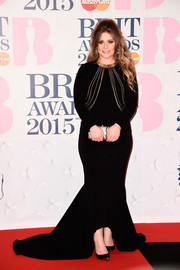 Ella Henderson wore a flattering black gown with a mermaid skirt by Katie Ermilio for the BRIT Awards.