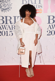 Lianne La Havas chose a lovely white dress with a matching white jacket by Heohwan Simulation for the BRIT Awards.
